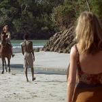 Legba, from Vers le Sud, stands between Ellen and Brenda, caught in an economic arrangement that exploits his body.