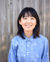 Frontal shot of Ellen Chang in light blue shirt with white dinosaur print